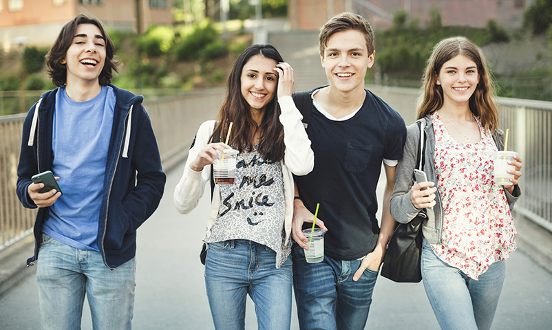 *** ROYALTY FREE - special pris *** Portrait of happy teenagers holding disposable glasses and smart phones on bridge. Keywords: 14-15 years, 16-17 years, Casual clothing, mixed race person, Bridge - Man Made Structure, day, fruit, drink, beverage, liquid, drink, beverages, drinks, Disposable Glass, Europe, photography, front view, leisure time, Four people, color image, refreshment, togetherness, Group of people, high school student, walking, Horizontal, holding, Hands In Pockets, hanging out, focus on foreground, juice, juices, caucasian ethnicity, communication, Arts Culture And Entertainment, latin american and hispanic ethnicity, smiling, lifestyle, happiness, food and drink, middle eastern ethnicity, mobile phone, Multi-Ethnic Group, portrait, enjoyment, fun, side by side, confidence, Scandinavia, Smart phone, city life, Stockholm, Drinking Straw, Sweden, Sodermalm, technology, looking at camera, teenage boys, teenage girls, teenager, three quarter length, wireless technology, bonding, connection, urban, outdoors, friend, friendship Modelreleased: YES Maskot RF, 45857-46756, 0416